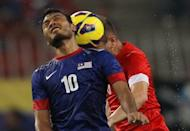 Malaysia's Safee Sali (L) fights for the ball with Singapore's Mustafic Fahrudin during their AFF Suzuki Cup Group B football match in Kuala Lumpur on November 25, 2012. Singapore beat the defending Southeast Asian champions 3-0