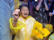 "A former South Korean ""comfort woman"" -- who was forced to serve as a sex slave for Japanese troops during World War II -- demonstrates outside the Japanese embassy in Seoul. China and South Korea have pressed Japan to face up to its wartime past, as festering territorial disputes flared and Asia marked the anniversary of Tokyo's World War II surrender"