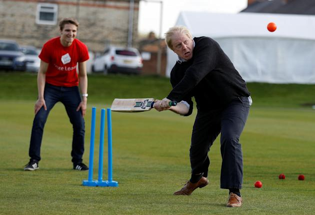 Former London Mayor Boris Johnson plays cricket during a Vote Leave event in Chester le Street, northern Britain.