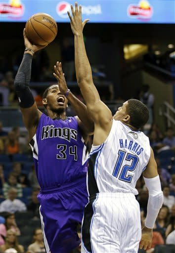 Big shooting night lifts Kings over Magic, 125-101