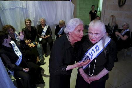 Holocaust survivors are seen backstage during a beauty contest for survivors of the Nazi genocide in Haifa