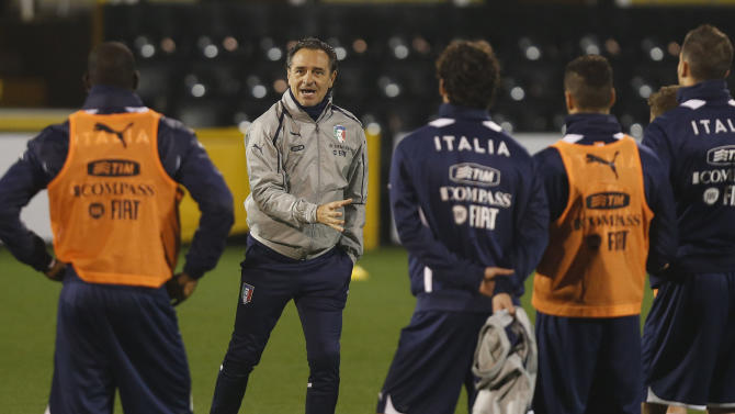 Italy's coach Cesare Prandelli, second left, instructs his players during a training session at Craven Cottage in London, Sunday, Nov. 17, 2013. Italy is to play a friendly soccer match against Nigeria on Monday Nov. 18 at Craven Cottage in London