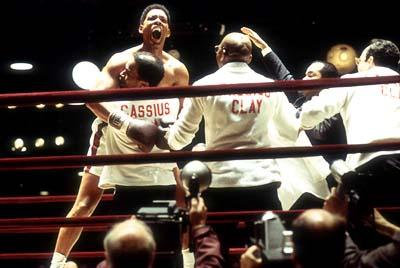 Drew ?Bundini? Brown ( Jamie Foxx ) embraces Muhammad Ali ( Will Smith ) while (L to R) Luis Sarria ( Laurence Mason ), Howard Bingham ( Jeffrey Wright ) and Dr. Ferdie Pacheco ( Paul Rodriguez ) look on in Columbia's Ali