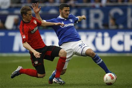 Bayer Leverkusen's Lars Bender tackles Schalke 04's Sead Kolasinac (R) during their German first division Bundesliga soccer match in Gelsenkirchen