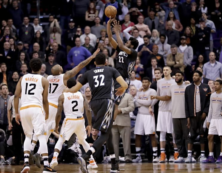 Andrew Wiggins rises to give the Wolves another win. (AP)