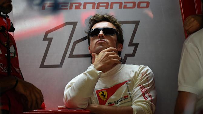 Formula 1 - Alonso frustrated and bored, but staying at Ferrari