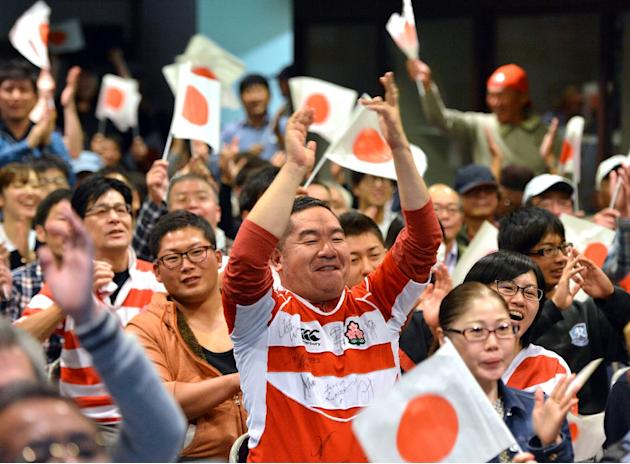 Japanese rugby fans celebrate their team's try during a public screening of the Rugby World Cup match against the United States in Kumagaya in Saitama prefecture, north of Tokyo, on October 12, 20