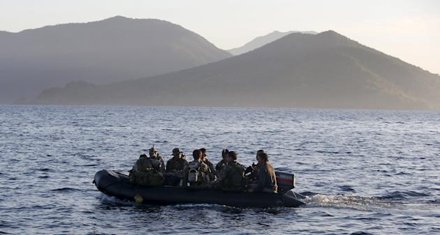 File photo of Philippine marines being transported on rubber boat from a patrol ship, after mission at disputed Second Thomas Shoal, as they return to naval forces camp in Palawan