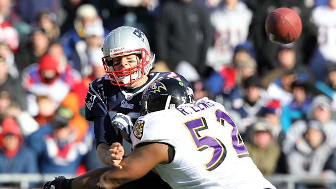 FOXBORO, MA - JANUARY 10: Tom Brady #12 of the New England Patriots is hit as he throws the ball by Ray Lewis #52 of the Baltimore Ravens during the 2010 AFC wild-card playoff game at Gillette Stadium on January 10, 2010 in Foxboro, Massachusetts. (Photo by Jim Rogash/Getty Images)