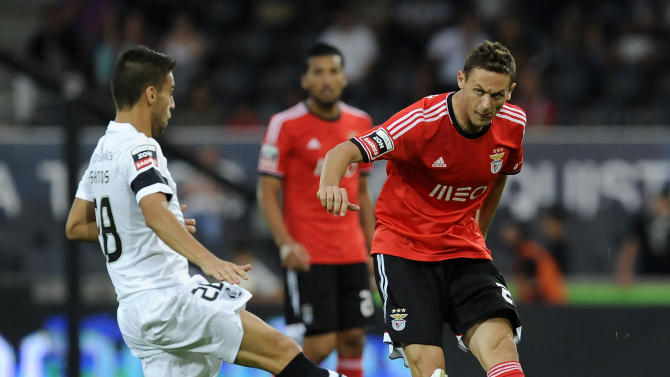 Benfica's Nemanja Matic, right, challenges Vitoria Guimaraes' Andre Santos, left, in a Portuguese League soccer match at D. Afonso Henrique stadium in Guimaraes, Portugal, Sunday, Sept. 22, 2013. Benfica won 1-0