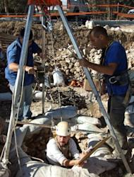 A handout picture released by Israel's Antiquities Authority shows Israeli archaeologists working at the site of a well that was discovered in the Jezreel Valley in the northern Galilee region. The well dates back to the Neolithic period some 8,500 years ago