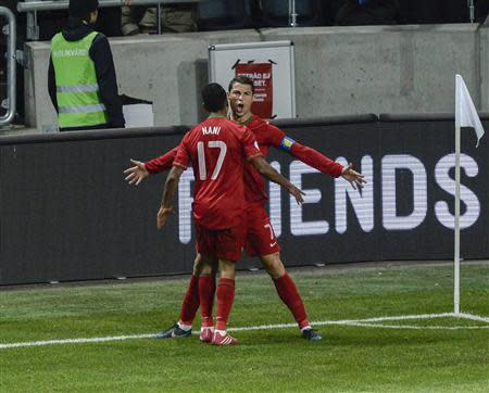 Portugal's Ronaldo celebrates scoring against Sweden during World Cup qualifier match in Stockholm