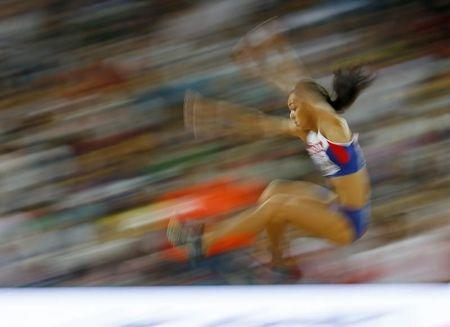 Johnson-Thompson of Britain competes in the women's long jump final during the 15th IAAF World Championships at the National Stadium in Beijing