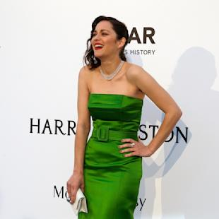 Actress Marion Cotillard laughs as she poses for photographers upon arrival for the amfAR Cinema Against AIDS benefit at the Hotel du Cap-Eden-Roc, during the 68th Cannes international film festival, Cap d'Antibes, southern France, Thursday, May 21, 2015. (AP Photo/Thibault Camus)
