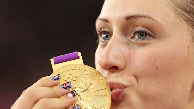 Britain's Laura Trott kisses her gold medal during the victory ceremony for the track cycling women's omnium at the Velodrome during the London 2012 Olympic Games