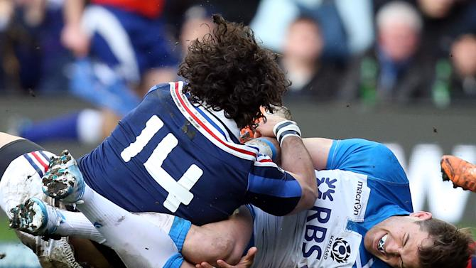 Scotland's Sean Lamont, right, tackles France's Yohan Huget during their Six Nations rugby union international match at Murrayfield in Edinburgh, Scotland, Saturday March 8, 2014. (AP Photo/Scott Heppell)