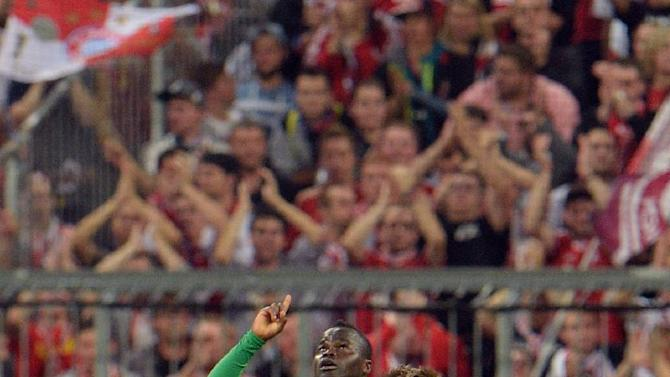 Hannover's Didier Ya Konan of Ivory Coast celebrates after scoring during the German soccer cup second round match between FC Bayern Munich and Hannover 96, in Munich, southern Germany, Wednesday, Sept. 25, 2013
