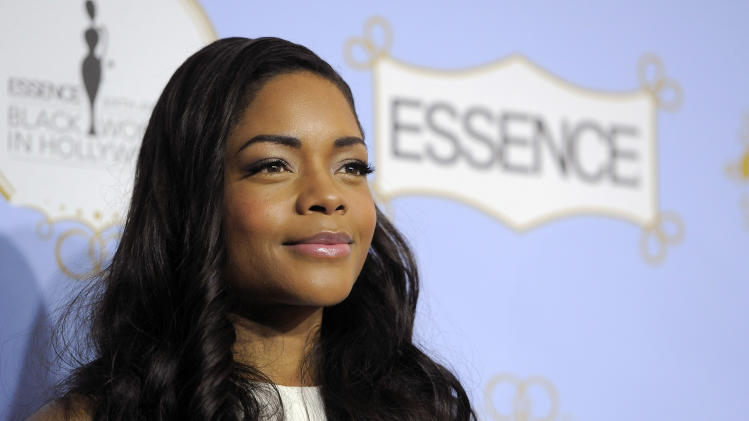 British actress Naomie Harris, recipient of the Lincoln Shining Star award, poses at the 6th Annual Black Women in Hollywood Luncheon at the Beverly Hills Hotel on Thursday, Feb. 21, 2013 in Los Angeles. (Photo by Chris Pizzello/Invision/AP)