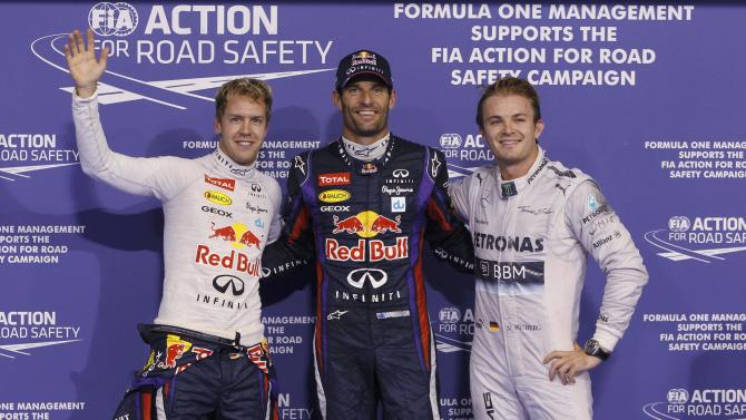Vettel of Germany, Webber of Australia and Rosberg of Germany pose for photographers after the qualifying session of the Abu Dhabi F1 Grand Prix at the Yas Marina circuit on Yas Island