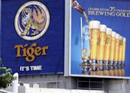 A huge billboard advertises Tiger Beer in Singapore in 2006. Fraser and Neave said Monday that Thai Beverage has raised its stake in the conglomerate, a move seen to boost its challenge to Heineken for control of Asia Pacific Breweries, the maker of Tiger Beer