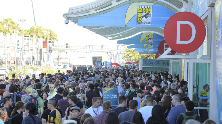 Fans wait in line to get into the Preview Night event on Day 1 of the 2013 Comic-Con International Convention on Wednesday, July 17, 2013 in San Diego. (Photo by Denis Poroy/Invision/AP)