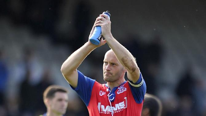 Adam Barrett has agreed a new contract with Gillingham