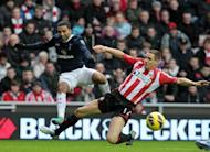 Sunderland defender Matthew Kilgallon (R) tackles Tottenham midfielder Aaron Lennon during the Premier League clash at The Stadium of Light in Sunderland, north-east England, on December 29, 2012. Tottenham climbed to third place in the Premier League after Lennon's strike capped his side's fightback in their 2-1 win on Saturday