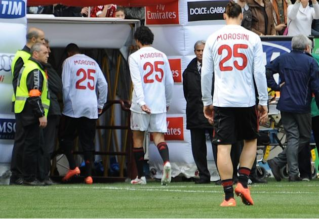 AC Milan's Swedish Forward Zlatan Ibrahimovic (L) And His Team Mates Wear  Warm-up Jerseys With The Name Of  Piermario AFP/Getty Images