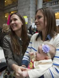 Candice Green-Berrett (R) and Megan Berrett attend a rally supporting same-sex marriage with their four-month-old daughter Quinn at the state capitol in Salt Lake City, Utah January 10, 2014. REUTERS/Sallie Dean Shatz