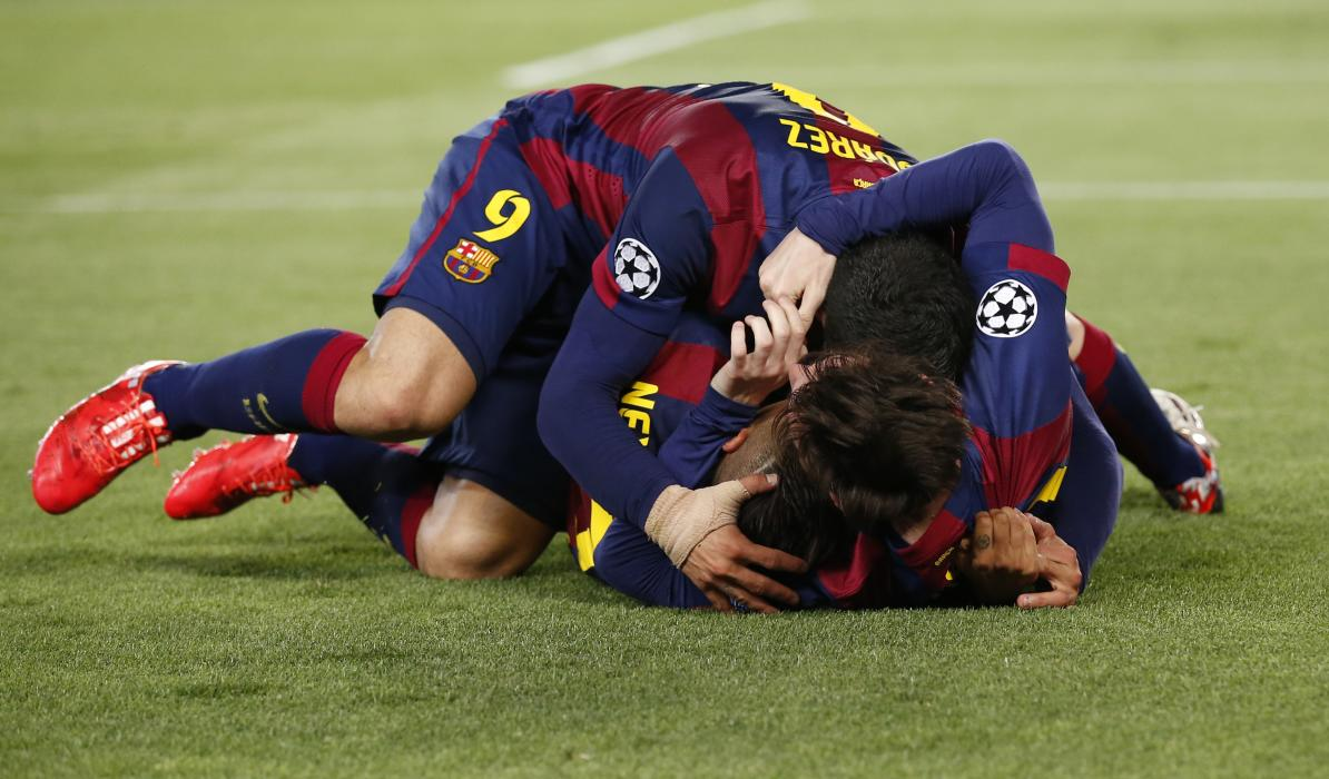 Football: Barcelona's Neymar celebrates with team mates after scoring their third goal