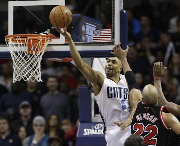 Charlotte Bobcats' Gerald Henderson (9) drives to the basket against Chicago Bulls' Taj Gibson (22) during the second half of an NBA basketball game in Charlotte, N.C., Wednesday, April 16, 20