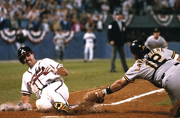 Sid Bream slides in ahead of Mike LaVallier's tag to win Game 7 of the 1992 NLCS. (Getty Images)