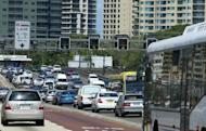 This file photo shows a busy street in central Sydney. Two Aboriginal teenagers aged 14 and 18 were shot by police in central Sydney on Saturday after mounting a crowded footpath in a stolen car and hitting a bystander as officers gave chase