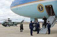 """US President Barack Obama salutes as he walks off Air foirce One upon his landing at Andrews Air force Base, Maryland, on December 27, 2012. Obama will host top congressional leaders including his bitter Republican rivals on Friday in a last-ditch bid to halt America's slide over the so-called """"fiscal cliff."""""""