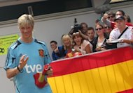 Spain's Fernando Torres waves to fans as he leaves a training session in Schruns. Sevilla striker Alvaro Negredo edged Roberto Soldado for the final striker's spot in defending champions Spain's squad for Euro 2012 that was announced by coach Vicent del Bosque