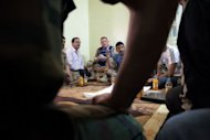 UN observers meet with Syrian rebels, opposition members and residents during a visit to Qusayr, 15 kms (nine miles) from Homs