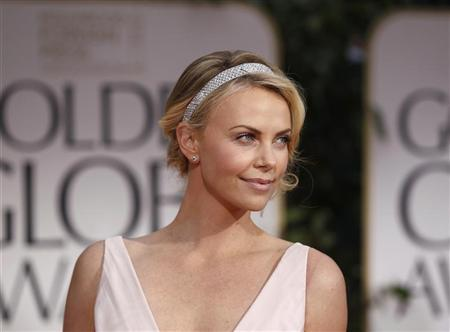 Actress Theron arrives at the 69th annual Golden Globe Awards in Beverly Hills