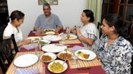 Former army chief Sarath Fonseka (C) having a dinner with his wife Anoma (C2) and daughters Aparna (R) and Apsara (L) following Fonseka's release from prison