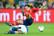 Spain midfielder Xavi Hernandez (top) is tackled by an Italian player during the final of the Euro 2012 football championships on July 1 at the Olympic Stadium in Kiev