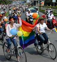 Cyclists holding balloons and rainbow flags take part in Vietnam's first ever gay pride parade on a road in Hanoi on August 5. The parade follows recent gay pride celebrations in Myanmar and Laos, reflecting signs of liberalising social attitudes in parts of Southeast Asia