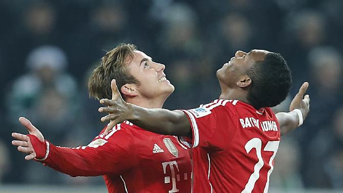 CORRECTS CITY - Bayern's Mario Goetze, left, and Bayern's David Alaba of Austria celebrate after scoring during the German first division Bundesliga soccer match between VfL Borussia Moenchengladbach and Bayern Munich in Moenchengladbach, Germany, Friday, Jan. 24, 2014