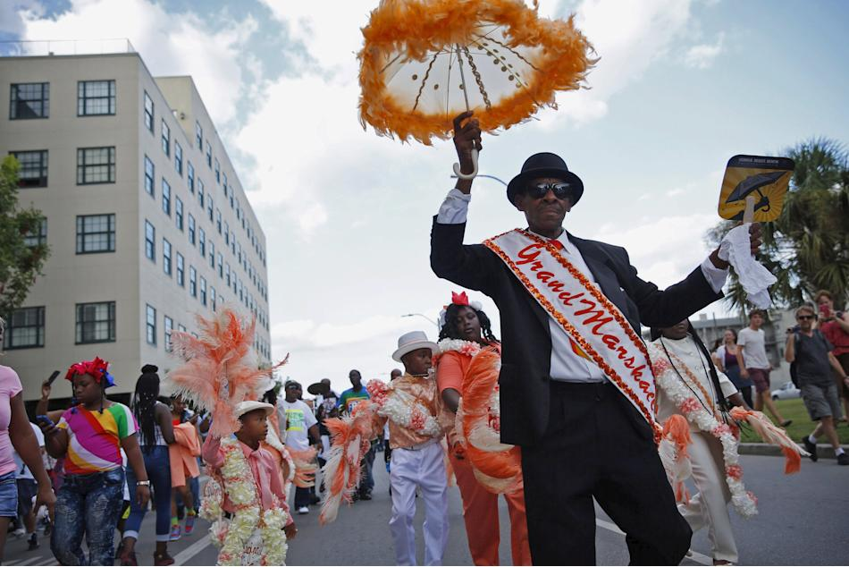 The Original Big 7 Junior Steppers parade through the Central Business District in a second line parade to mark the tenth anniversary of Hurricane Katrina in New Orleans