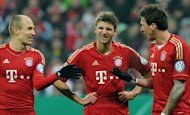 (From L) Bayern Munich's Arjen Robben, Thomas Mueller and Mario Mandzukic are pictured during their German Cup match against Borussia Dortmund on February 27, 2013. Robben is prepared to return to Bayern's bench for Sunday's Bundesliga match at Hoffenheim