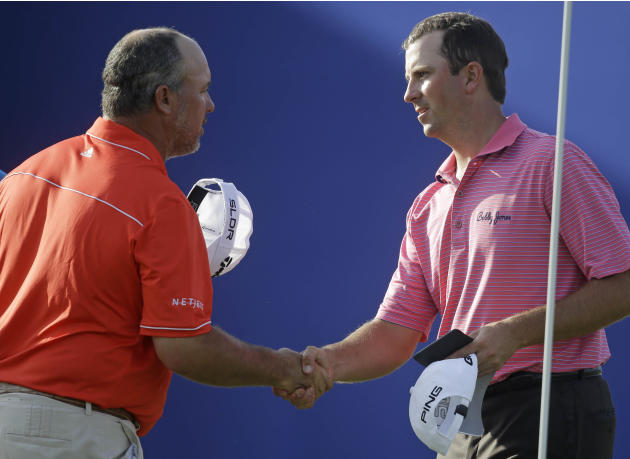 Michael Thompson, right, shakes hands with Boo Weekley the 9th green during the opening round of the PGA Zurich Classic golf tournament at TPC Louisiana in Avondale, La., Thursday, April 24, 2014. (AP