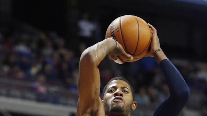 Indiana Pacers forward Paul George (24) takes a shot over Detroit Pistons guard Rodney Stuckey (3) during the first half of an NBA basketball game Tuesday, Nov. 5, 2013, in Auburn Hills, Mich. George score 31 points in a 99-91 win over the Pistons