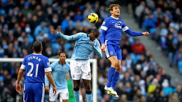 Manchester City's Yaya Toure (centre) and Everton's Nikica Jelavic (right) battle for the ball