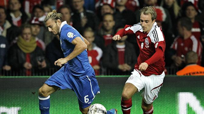 Italy's Federico Balzaretti and Denmark's Christian Eriksen during the 2014 World Cup Group B qualifying soccer match between Denmark and Italy at Parken Stadium in Copenhagen, Denmark, Friday Oct. 11, 2013