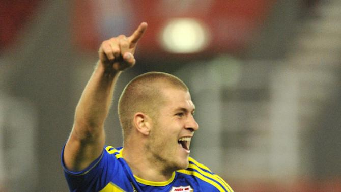James Collins celebrates a goal for new club Swindon