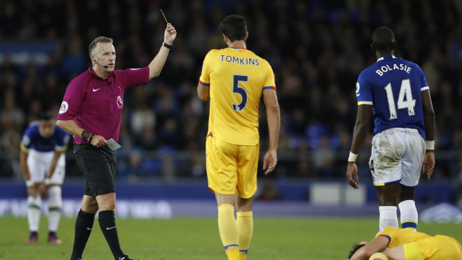 Everton's Yannick Bolasie is shown a yellow card by referee Jonathan Moss