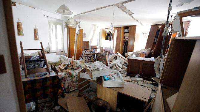 The interior of a damaged house is seen following an earthquake in Pescara del Tronto